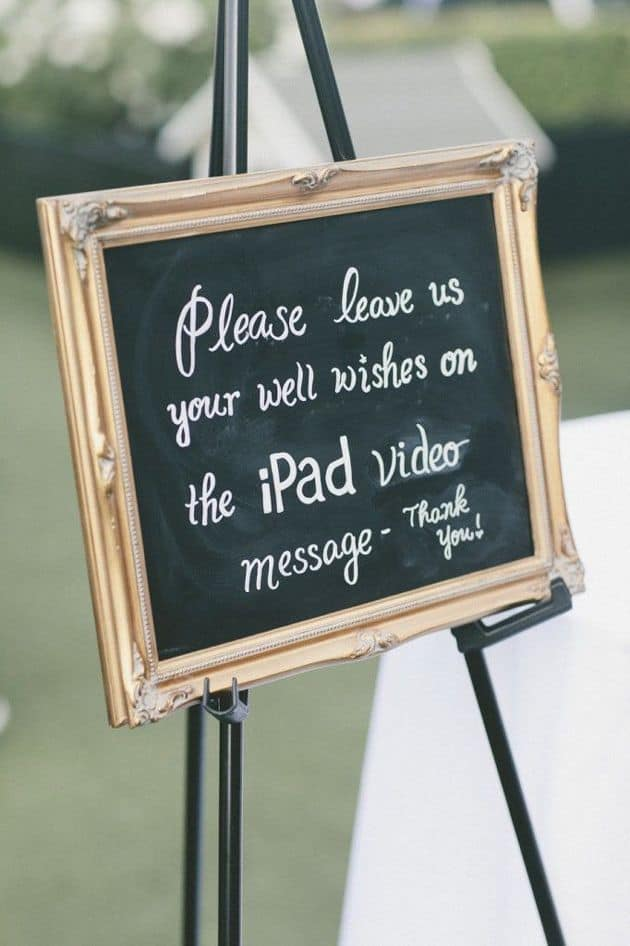 "Chalk sign that reads, ""Please leave us your well wishes on the iPad video message - Thank you!"""
