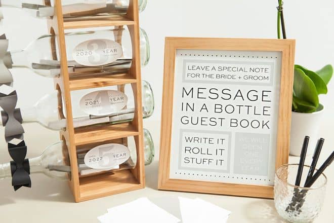 message in a bottle wedding guest book idea on a rack with a sign explaining what to do