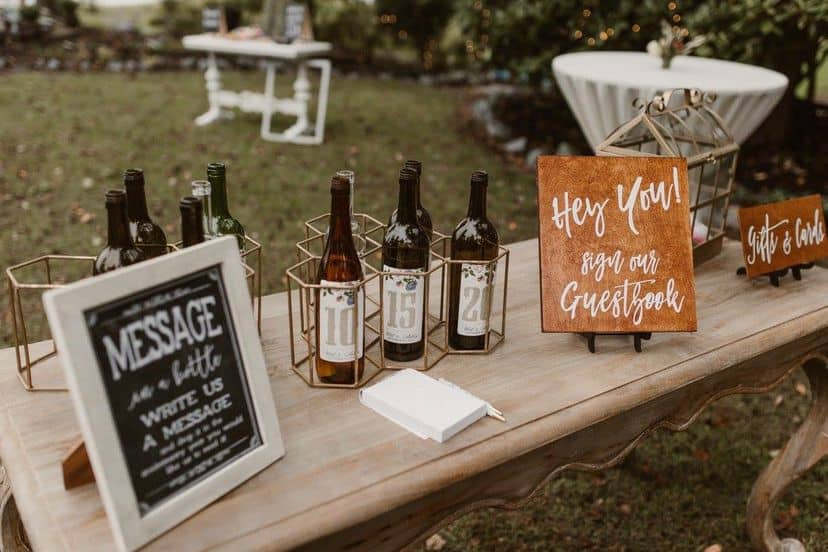 Message on a bottle wedding guest book idea with sign explaination