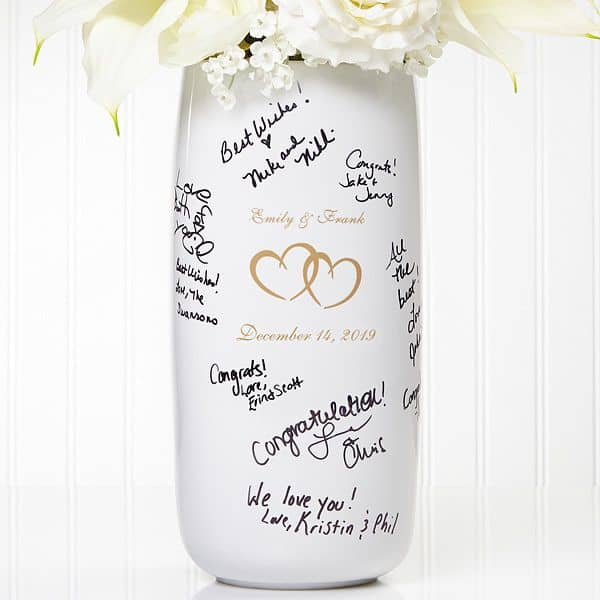 White vase with wedding guest signatures on it