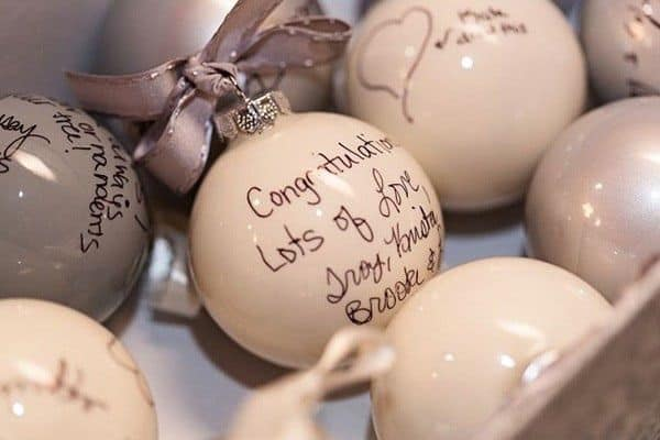 Wedding guest signatures on white Christmas ornaments
