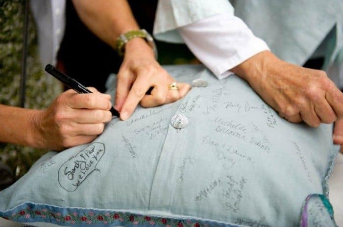Wedding guest signatures on a pillow