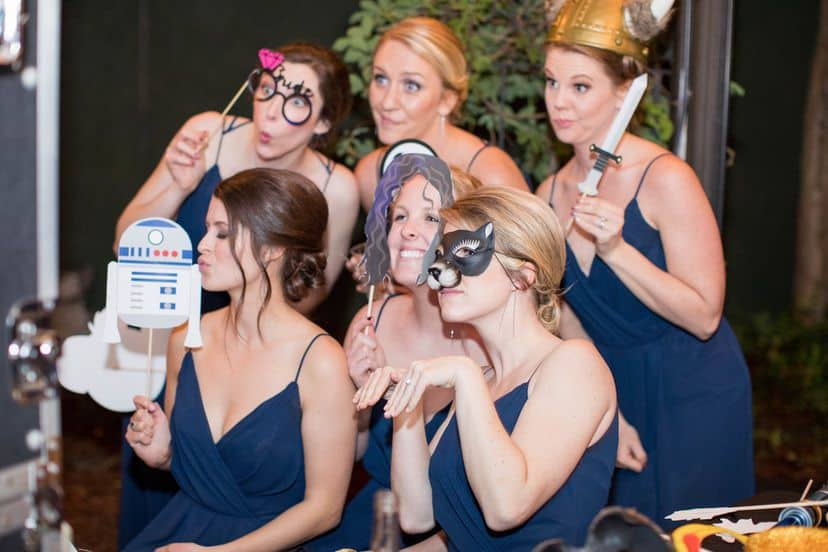 6 bridesmaids with props at a photo-booth
