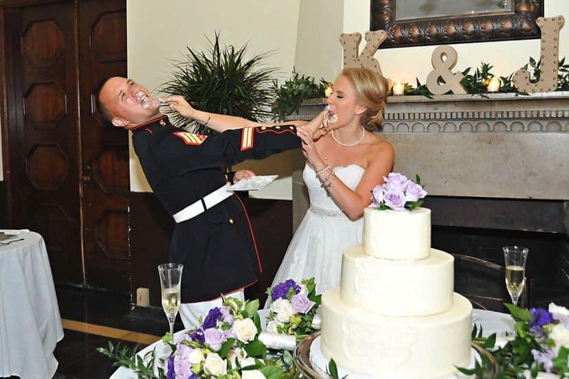 Kristen and Josh Loflin wedding photo smooshing cake in each other's face